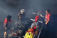 Jun 17, 2016; Bristol, TN, USA; Crew members with NHRA top fuel Harley motorcycle rider Ron Gledhill during qualifying for the Thunder Valley Nationals at Bristol Dragway. Mandatory Credit: Mark J. Rebilas-USA TODAY Sports