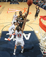 CHARLOTTESVILLE, VA- DECEMBER 6:  Mike Morrison #22 of the George Mason Patriots shoots over Mike Scott #23 of the Virginia Cavaliers during the game on December 6, 2011 at the John Paul Jones Arena in Charlottesville, Virginia. Virginia defeated George Mason 68-48. (Photo by Andrew Shurtleff/Getty Images) *** Local Caption *** Mike Morrison;Mike Scott