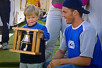 Mick Fanning (AUS) won the 2001 Rip Curl Pro at Bells Beach, Victoria, Australia. Fanning was a sponsors wildcard and stormed the field, defeating Danny Wills (AUS) in the finals.   Wills, with is son Jayden, pose with the famous Bells trophy. Photo: joliphotos.com