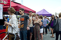 Foodies from around the city flock to opening day at the Smorgasburg in the Williamsburg neighborhood of Brooklyn in New York on Saturday, May 21, 2011. The new marketplace features a Greenmarket and prepared food made in Brooklyn by small entrepreneurs. The market is the creation of the operators of the wildly successful Brooklyn Flea. (© Frances M. Roberts)
