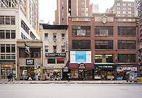 Stores as undeveloped real estate along the east side of Sixth Avenue in the Garment Center in New York on Sunday, January 26, 2014. (© Richard B. Levine)