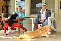 NWA Democrat-Gazette/ANDY SHUPE<br /> Angie Pratt (left), executive director of Soldier On Soldier Dogs, and Marsha Wyatt, veteran coordinator, pose Thursday, May 14, 2015, with Molly, a British Labrador retriever who is being prepared for training as a service dog at the organization's Fayetteville office. The organization is a non-profit organization that provides service dogs for veterans with post-traumatic stress disorder and pairs volunteers with foster dogs to train.