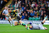 Harry Mallinder of Northampton Saints is tackled by Tom Homer of Bath Rugby. Aviva Premiership match, between Northampton Saints and Bath Rugby on September 3, 2016 at Franklin's Gardens in Northampton, England. Photo by: Patrick Khachfe / Onside Images