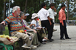 Russ Christensen and Sharon Moller, of Veterans for Peace, sit with Vietnamese war veterans at Truong Son Martyrs Cemetery in Quang Tri province, Vietnam. The cemetery contains the graves of about 10,300 communist soldiers who died along the Ho Chi Minh Trail supply network into South Vietnam during the conflict from 1959 to 1975. April 24, 2013.