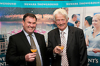 Chief Executive Officer of the Newark & Nottinghamshire Agricultural Society Adrian Johnson (left) shares a drink with the Vice Chairman of the Society John Brydon