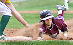 WATERBURY CT. 19 April 2017-041817SV08-#24 Steven Marinaro of Naugatuck High is tagged out by #27 Matt Bonvicini of Holy Cross High in the 3rd inning during NVL baseball action in Waterbury Wednesday.<br /> Steven Valenti Republican-American