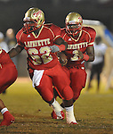Lafayette High's Jeremy Liggins (1) runs behind Lafayette High's D&Otilde;Andre Greer (62) vs. Pontotoc in Oxford, Miss. on Friday, September 23, 2011. Lafayette won 48-7 for the school's 22nd consecutive win.