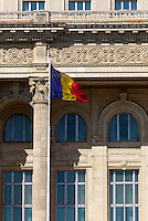 Romain Flag outside the Palace of the Parliament (Also known as Ceausescu&rsquo;s Palace or House of The People) in Bucharest, Romania. Built 1983-1989. Architect: Anca Petrescu