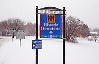 Snow covered historical downtown sign in Charlottesville, Va.
