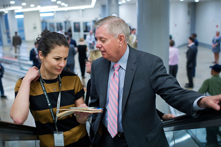 UNITED STATES - APRIL 19: Sen. Lindsey Graham, R-S.C., talks with a reporter in the subway before the Senate Policy luncheons in the Capitol, April 19, 2016. (Photo By Tom Williams/CQ Roll Call)
