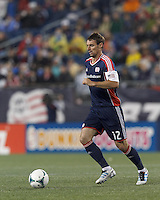 New England Revolution substitute midfielder Andy Dorman (12) at midfield. In a Major League Soccer (MLS) match, the New England Revolution (blue) tied New York Red Bulls (white), 1-1, at Gillette Stadium on May 11, 2013.
