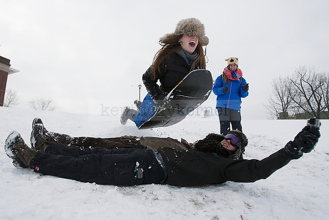"""Sophomore Christina Heilman flys over a ramp while sledding in """"The Bowl"""" outside the William T. Young Library in Lexington, Ky.,on Monday, February 3, 2014. Photo by Michael Reaves   Staff"""