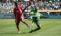 Cedric Avinel (right) kicks the ball ahead of Orlando Rodriguez (19). Guadeloupe defeated Panama 2-1 during the First Round of the 2009 CONCACAF Gold Cup at Oakland Coliseum in Oakland, California on July 4, 2009.