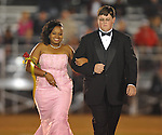 Sophomore maid DanEisha Phillips is escorted by Devin Smith at Lafayette High vs. Lewisburg in Homecoming football action in Oxford, Miss. on Friday, September 30, 2011.