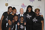 Figure Skating in Harlem celebrates 20 years - Champions in Life benefit Gala on May 2, 2017 presenting Scott Hamilton with The Power of Inspiration Award by Andrea Joyce and poses with skaters at 583 Park Avenue, New York City, New York. . (Photo by Sue Coflin/Max Photos)