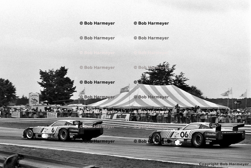 ELKHART LAKE, WI - AUGUST 21: The Ford Mustang GTP driven by Bobby Rahal and Geoff Brabham leads the team car driven by Klaus Ludwig and Tim Coconis during the Budweiser 500 on August 21, 1983, at Road America near Elkhart Lake, Wisconsin.