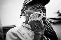 A man plays the harmonica in a camp for those displaced by the recent earthquake in Petionville, outside Port-au-Prince, Haiti.