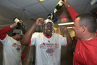 Vladimir Guerrero celebrates clinching the 2004 American League Western Division crown with champagne. Anaheim Angels vs Oakland Athletics. Oakland, CA 10/2/2004 MANDATORY CREDIT: Brad Mangin