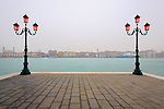 A very typical Venetian view, a simple, geometrical composition: a quay and two lamp posts on the Giudecca, and the strip of buildings of downtown Venice in the background. Taken on a hazy evening of mid January, about 30 minutes after sunset.