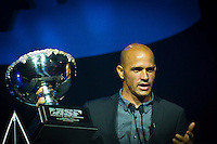 GOLD COAST, Queensland/Australia (Friday, February 24, 2012) Kelly Slater (USA)  x 11 World Champion.  The 29th Annual ASP World Surfing Awards went off tonight at the Gold Coast Convention and Exhibition Centre with the worlds best surfers trading the beachwear for formal attire as the 2011 ASP World Champions were officially crowned.. .Kelly Slater (USA), 40, and Carissa Moore (HAW), 19, took top honours for the evening, collecting the ASP World Title and ASP Womens World Title respectively.. .I have actually been on tour longer than some of my fellow competitors have been alive, Slater said. All joking aside, its truly humbling to be up here and honoured in front of such an incredible collection of surfers. I want to thank everyone in the room for pushing me to where I am...In addition to honouring the 2011 ASP World Champions, the ASP World Surfing Awards included new accolades voted on by the fans and the surfers themselves...For the first time in several years, ASP Life Membership was awarded to Hawaiian legend and icon of high-performance surfing, Larry Bertlemann (HAW), 56...Where surfing is today is where I dreamed it should be in the 70s, Bertlemann said. You guys absolutely deserve this and Im so honored to be up here in front of you all tonight..Grammy Award-winning artists Wolfmother and The Vernons rounded out the nights entertainment which was all streamed LIVE around the world on YouTube.com..Photo: joliphotos.com