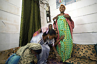 "Djibouti. Djibouti province. Djibouti. Association ""Afisn"" where street workers, all commercial sex workers (CSW) meet weekly and talk about the HIV Aids disease. Group of black muslim women. The Global Fund through the djiboutian Ministry of Health supports the condoms distribution with an Aids grant (financial aid).  © 2006 Didier Ruef"