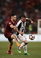 Calcio, Serie A: Roma, stadio Olimpico, 14 maggio 2017.<br /> Juventus Stefano Sturaro (r) in action with AS Roma's Kostas Manolas (l) during the Italian Serie A football match between AS Roma and Juventus at Rome's Olympic stadium, May 14, 2017.<br /> UPDATE IMAGES PRESS/Isabella Bonotto