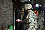 A teenage girl looks apprehensive as an Iraqi soldier offers her a leaflet that urges local residents in Mosul, Iraq to not cooperate with terrorists and to call in tips to authorities on al Qaida and other insurgent groups. U.S. commanders say a new string of combat outposts and daily patrols by U.S. and Iraqi troops are pushing insurgents out of the city. March 1, 2008. DREW BROWN/STARS AND STRIPES