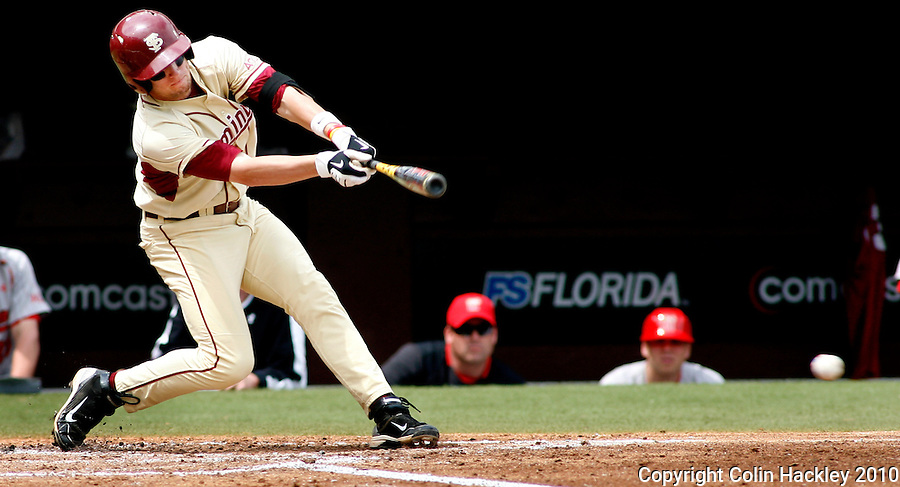 TALLAHASSEE, FL 3/28/10-FSU-MARY BASE10 CH02-Florida State's Tyler Holt connects for a double in the second inning against Maryland Sunday at the Dick Howser Stadium in Tallahassee. The double was Holt's second step in hitting a cycle in order. Holt was the first Seminole since Stephen Drew to perform such a feat. Drew hit for the cycle against Wake Forest in 2004. The Seminoles beat the Terrapins 9-5. ..COLIN HACKLEY PHOTO