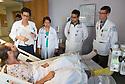 St. Mary's Medical Center. Patient, release 20120523002, from left, Jennna Pariseau, class of 2014, Azucena Jumapao, M.D., Kishore Kumar, M.D., release 20120523001, Jonathan Galli, class of 2014.