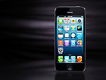 Apple iPhone 5 black smartphone isolated on stylish black background with copy space