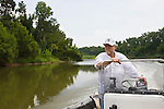 Mike Leebron, driving a John boat, on the Brazos River, Brazoria County, Texas.