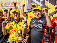 Aug 21, 2016; Brainerd, MN, USA; NHRA funny car driver Del Worsham (left) celebrates with team owner Connie Kalitta after winning the Lucas Oil Nationals at Brainerd International Raceway. Mandatory Credit: Mark J. Rebilas-USA TODAY Sports