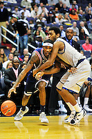 Will Barton of the Tigers has a tough time getting around the defense of Hoyas' Hollis Thompson. Georgetown defeated Memphis 70-59 at the Verizon Center in Washington, D.C. on Thursday, December 22, 2011. Alan P. Santos/DC Sports Box