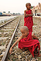 Two Samaneras wait for a train. A monk first ordains as a Samanera (novice). They usually are between the age of 4 and 20.