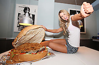 NO REPRO FEE. 3/2/2011.Vogue opens the Counter.  Fade Street star Vogue Williams tucks into a 20lb giant hamburger at the opening of the Counter restaurant in Suffolk St. Dublin. Picture James Horan/Collins Photos