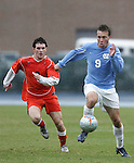 Carolina's Michael Harrington (9) is chased by Virginia's Nico Colaluca (l) in the driving rain on Sunday, November 27th, 2005 at Fetzer Field in Chapel Hill, North Carolina. The University of North Carolina Tarheels defeated the University of Virginia Cavaliers 2-1 in a NCAA Men's Soccer Tournament Round of 16 game.