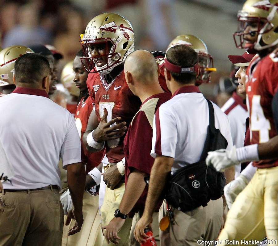 TALLAHASSEE, FL 9/17/11-FSU-OU091711 CH-Florida State EJ Manuel grimaces as he leaves the field after injuring his shoulder during second half action against Oklahoma Saturday at Doak Campbell Stadium in Tallahassee. The Seminoles lost to the Sooners 23-13. Manuel left the game a few plays later and did not return..COLIN HACKLEY PHOTO