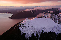 Aerial photographs at sunset where snow looks like ice cream topping the South Chilkat mountains in Alaska.