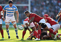 Sonatane Takulua of Tonga passes the ball. Rugby World Cup Pool C match between Argentina and Tonga on October 4, 2015 at Leicester City Stadium in Leicester, England. Photo by: Patrick Khachfe / Onside Images