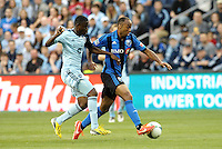 Patrice Bernier (8) midfield Montreal Impact  goes past Peterson Joseph (19) midfield Sporting KC.<br />