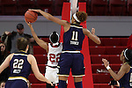 29 December 2016: Notre Dame's Brianna Turner (11) blocks a shot by NC State's Dominique Wilson (22). The North Carolina State University Wolfpack hosted the University of Notre Dame Fighting Irish at Reynolds Coliseum in Raleigh, North Carolina in a 2016-17 NCAA Division I Women's Basketball game. NC State won the game 70-62.