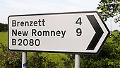 Road signs giving directions and distances.
