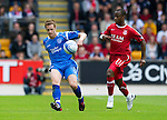 St Johnstone v Aberdeen...21.08.10  .Alan Maybury on debut against Sone Aluko.Picture by Graeme Hart..Copyright Perthshire Picture Agency.Tel: 01738 623350  Mobile: 07990 594431