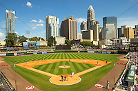 Sports action photography of the Charlotte Knights at their BB&amp;T BallPark - located in Uptown Charlotte, NC. BB&amp;T Ballpark is the home of the International League AAA Charlotte Knights baseball team. The  10,000 seat natural grass field is located against the beautiful Center City Charlotte skyline. The stadium overs a panoramic view of the Charlotte, North Carolina skyline.<br /> <br /> Charlotte Photographer - PatrickSchneiderPhoto.com