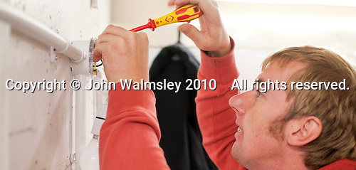 Student electrician installing domestic wiring, Able Skills, Dartford, Kent.