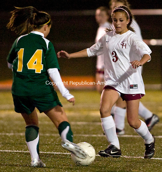 WATERBURY, CT - 20 OCTOBER 2008 -102008JT14--<br /> Sacred Heart's Angel LaPlante tries to dribble past Holy Cross' Alyssa Addona during Monday's game at Municipal Stadium.<br /> Josalee Thrift / Republican-American