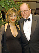 Washington, DC - May 1, 2004 -- John McLaughlin and his wife, arrive for the 2004 White House Correspondents Association Dinner in Washington, D.C. on May 1, 2004..Credit: Ron Sachs / CNP.(RESTRICTION: No New York Metro or other Newspapers within a 75 mile radius of New York City)