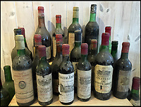 BNPS.co.uk (01202 558833)<br /> Pic: GigglingSquid/BNPS<br /> <br /> Restaurateurs struck it lucky when they uncovered a hidden wine cellar containing &pound;20,000 of vintage wines under their new premises.<br /> <br /> The unexpected discovery was made in a former Italian eatery by builders working at the premises for its new owners.<br /> <br /> They uncovered a trap door and underneath it were stairs to a cellar with decorative old wine bottles welded into the walls and Second World War style lanterns.<br /> <br /> After contending with 2ft of gushing water, they found cases of unopened wine bottles, the contents of which would entice any connoisseur, including several bottles of Chateau Latour.