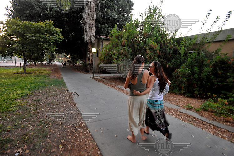 Young women hang out in the Degania Kibbutz, the first Israeli kibbutz, founded in 1910 by Russian immigrants.