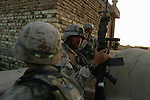 Marines from 1st BN 4th Marines and the 11th Marine Expeditionary Unit fight Mehdi Army gunmen on the first day of the August 2004 Battle of Najaf.